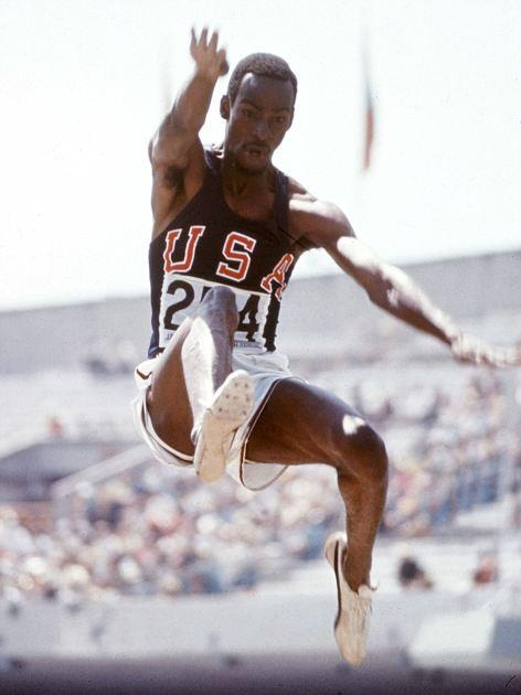 Bob Beamon breaking the long jump world record, Mexico City, 1968 Olympic Games. Men's Long Jump.