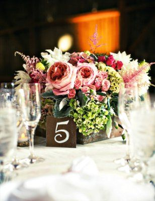 Wedding Centerpiece with with a romantic yet rustic charm.