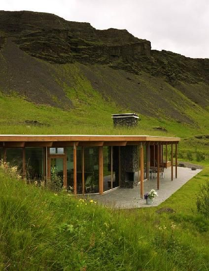 modern, blending in with a sod roof