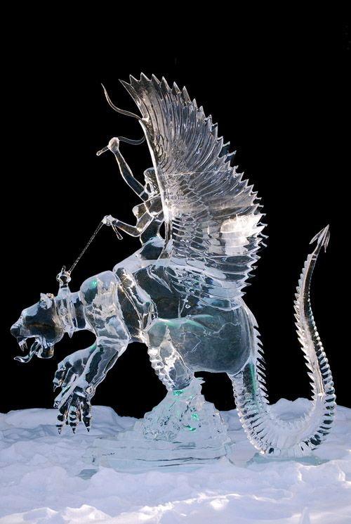 Stunning fantasy sculpture carved from a single block of ice. MPC Fairbanks