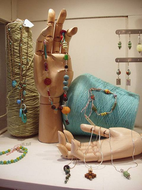 jewelry display. Thing in background... Paint sticks, drill holes, mount horizontal on something