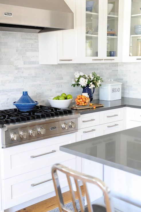 white cabinets + marble linear backsplash + gray quartz