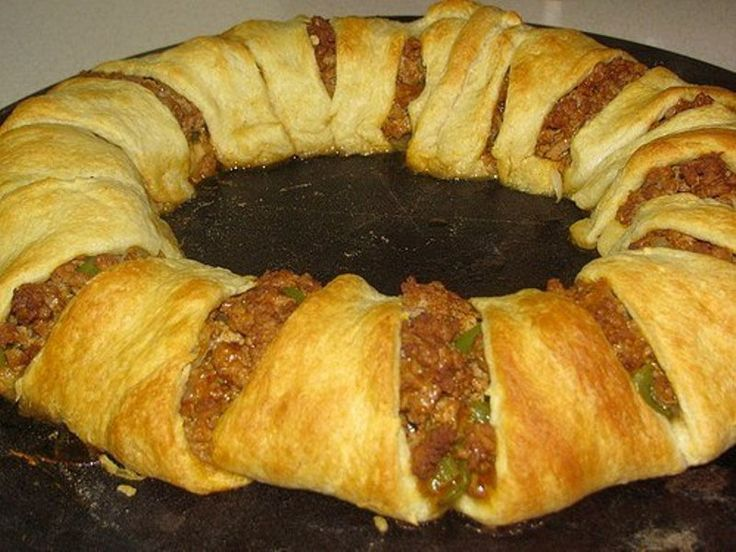 Ingredients:  1 Pound Ground Beef  1 Package (1.25 oz.) Taco Seasoning Mix  1 Cup Shredded Cheddar Cheese  Water (as called for on seasoning packet)  2 8-oz tubes of refrigerated crescent rolls  Optional Center Ingredients  1 medium green bell pepper  1 Cup Salsa  3 Cups