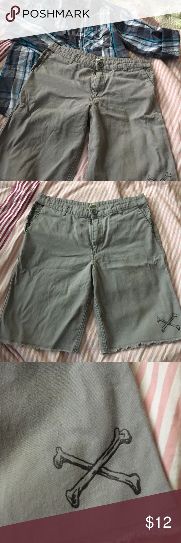 Boys skater style khaki shorts Faded Glort skater style boys shorts. Only worn a couple times. In great condition. Has one little spot on the leg but came like that. I think it was from the printing process when putting the crossbones on. Faded Glory Bottoms Shorts