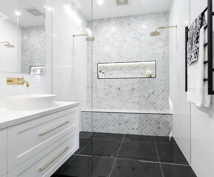 We're swooning over those tiles (and towels) used by @juliaandsasha in their luxe Master Bathroom! Shop the look at The Block Shop now. #theblockshop #9theblock #roomreveals