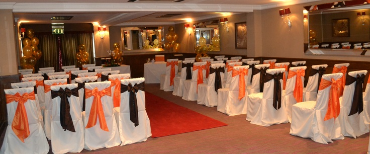 Alternating Chocolate and Orange Satin Bows on White Chair Covers