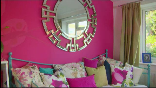 Aztec round mirror featured above sofa bed. As seen on Cowboy Builders & Bodge Jobs