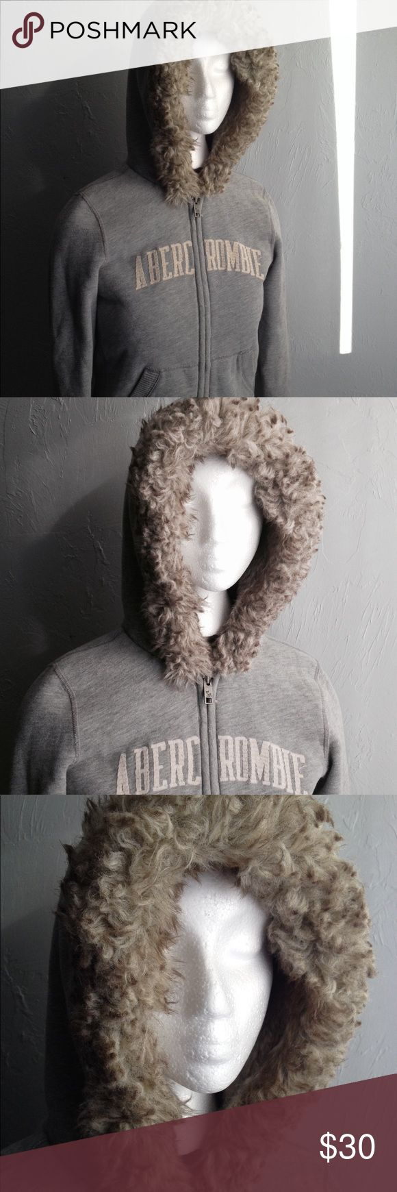 ABERCROMBIE Faux Fur Zip Up Hooded Sweatshirt Adorable and in wonderful shape! Slate gray hoodie with unreal soft faux fur interior and faux fur lining on the hood. ABERCROMBIE written across the front in beige. Women's size L. Abercrombie & Fitch Tops Sweatshirts & Hoodies