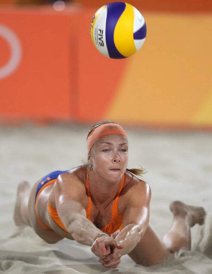 Netherlands' Madelein Meppelink dives for a ball during a women's beach volleyball match against Venezuela at the 2016…
