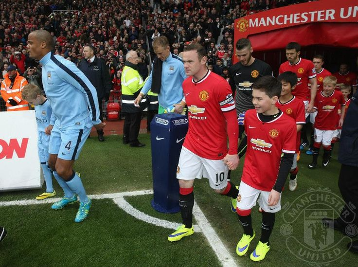 Exiting the tunnel ahead of Manchester Derby at Old Trafford.