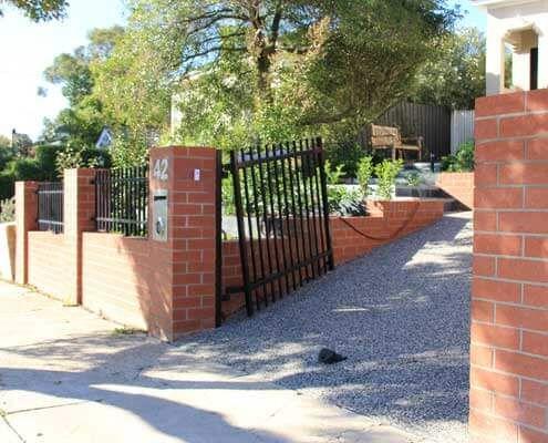 A brick fence and garden retaining walls built in Glen Iris