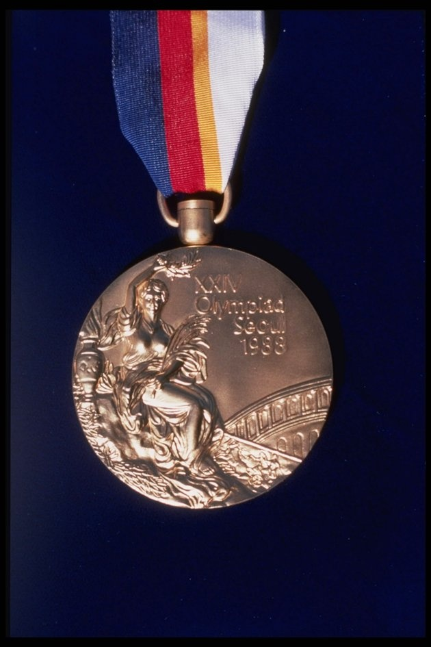 Close-ups of Olympic medals - A closeup of a Gold Medal for the 1988 Olympic Games in Seoul, South Korea. (Photo by Allsport).
