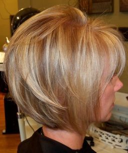 Bold blond & warm lowlights for   contrast.. Slightly angled bob is great for fine hair.