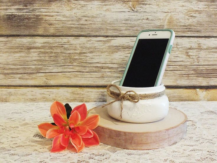 Rustic desk accessories are elevated to a elegant IPhone holder with the addition of a hand painted mason jar.