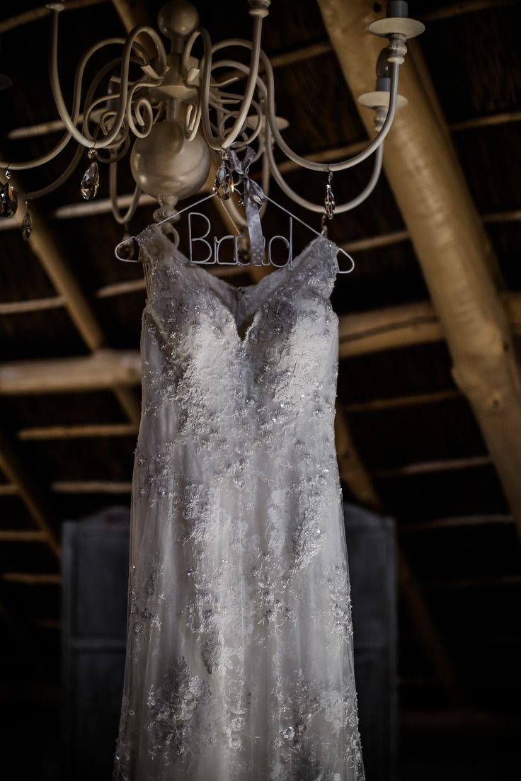 Bride's dress | SouthBound Bride www.southboundbride.com/proteas-pallets-rustic-wedding-at-leeuwrivier-by-nikki-meyer-martine-bruno Credit: Nikki Meyer