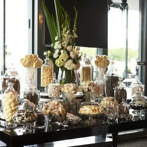 """Candy buffet with cards left at each table saying: Ashley & Peter are Mr & Mrs, we're sending our thanks with lots of kisses. But before you leave our special day, there's something sweet to take away!"""""""