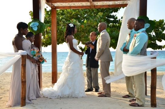 Couples Negril Jamaica All-Inclusive Destination Beach Wedding. Tan bridesmaids dresses, blue shirts, tropical flower bouquets-  Charlotte and Carl