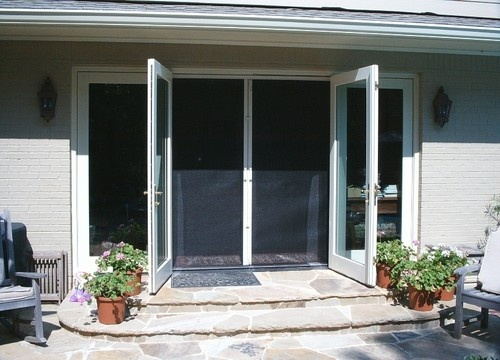 Inswing outswing and sliding glass doors these phantom retractable screens allow you to open for Exterior french doors with retractable screens