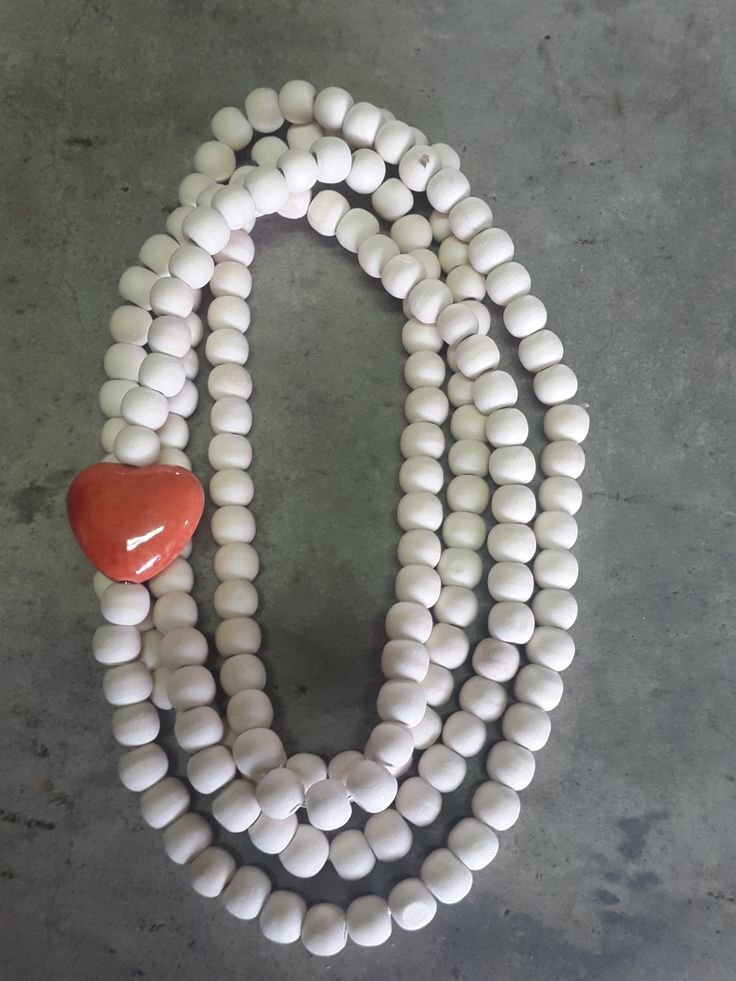 Necklace with natural wooden beads and orange heart
