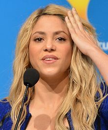 Shakira Isabel Mebarak Ripoll (pronounced: [ʃaˈkiɾa isaˈβel meβaˈɾak riˈpol]; born February 2, 1977),[2] (English /ʃəˈkɪərə/)[3] is a Colombian singer, songwriter, dancer, record producer, choreographer, and model. Born and raised in Barranquilla, she began performing in school, demonstrating Latin, Arabic, and rock and roll influences and belly dancing abilities.  Shakira has served as a coach on the American version of The Voice, having appeared in two of its seven seasons