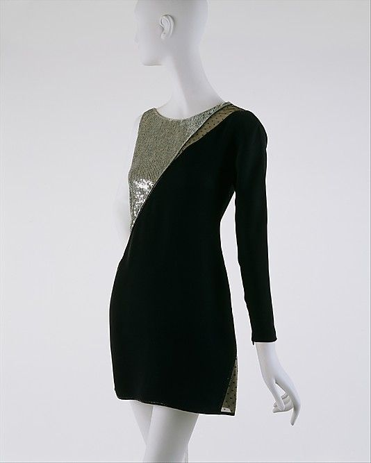 Black silk cocktail dress with silver lamé panel, by Geoffrey Beene, American, 1991.