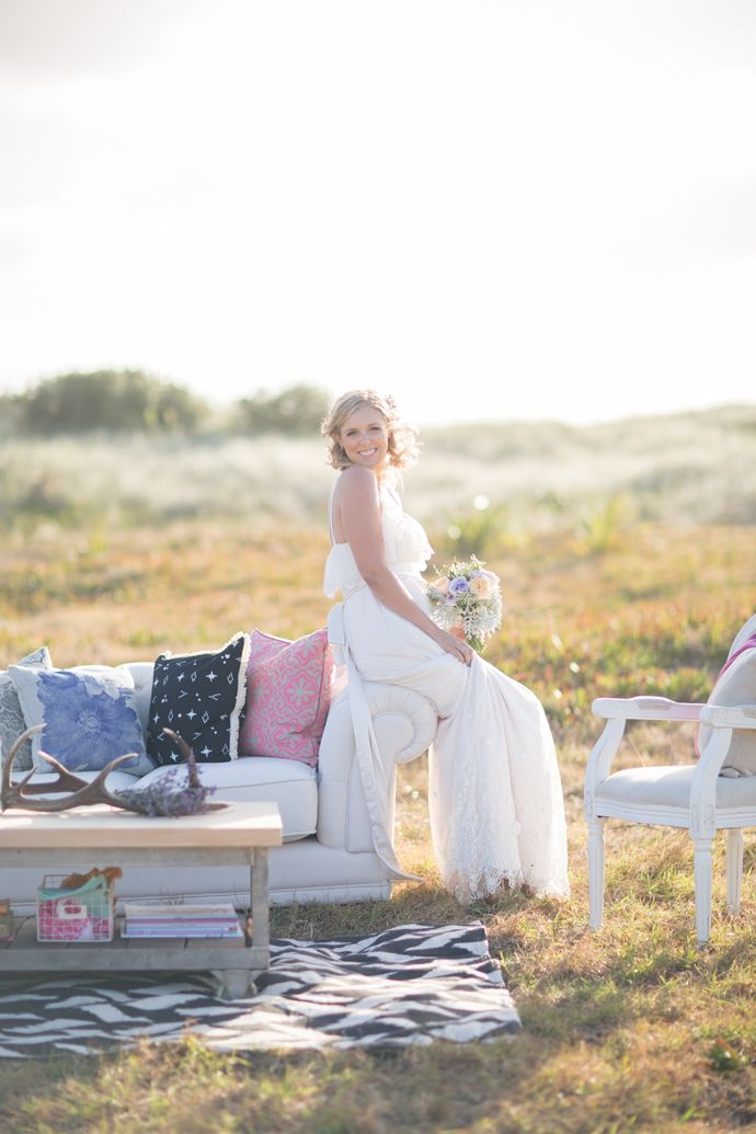 The beautiful bride in our bright, modern outdoor intimate lounge | Featured on paperandlace.com | Vintage Furniture Hire | www.borrowandbeau... | Furniture and Styling: Borrow and Beau | Photography: PoppyMoss Photography | Rug and cushions: Collected by LeeAnn Yare |