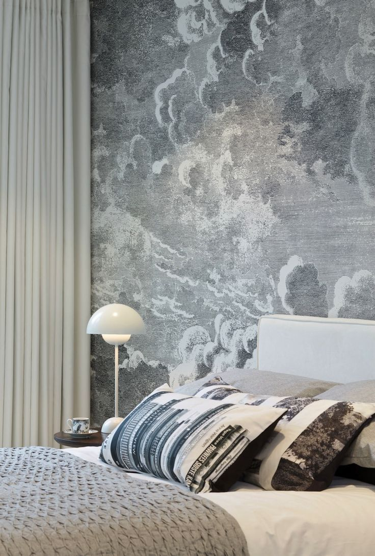 Bedroom with cloud wallpaper by Fornasetti at Cole & Son - Decoist