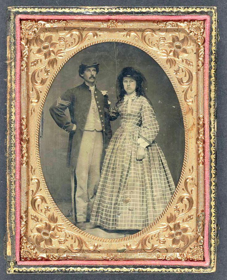 Unidentified Soldier In Union Sergeant's Frock Coat And Forage Cap With Unidentified Woman In Dress And Hat With Veil Between 1861 And 1865.