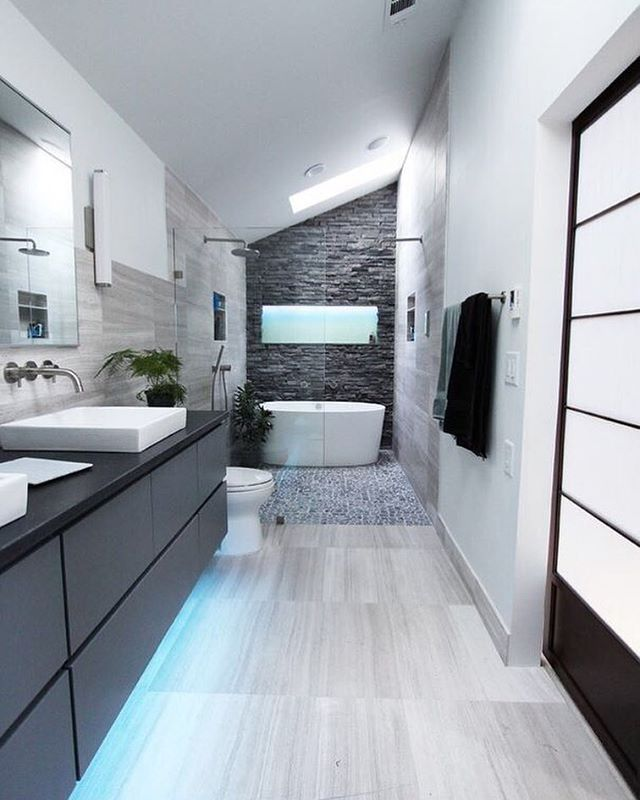 A Long Narrow Bathroom With A Slanted Ceiling Modern Fixtures And Cool Blu Contemporary