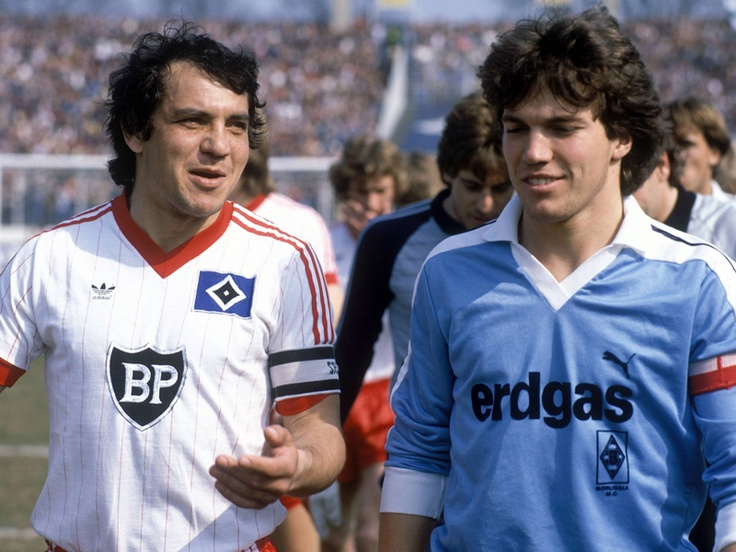 Small talking captains… Hamburg's Felix Magath and Borussia M'Gladbach's Lothar Matthaus before a Bundesliga match, April 14, 1984.