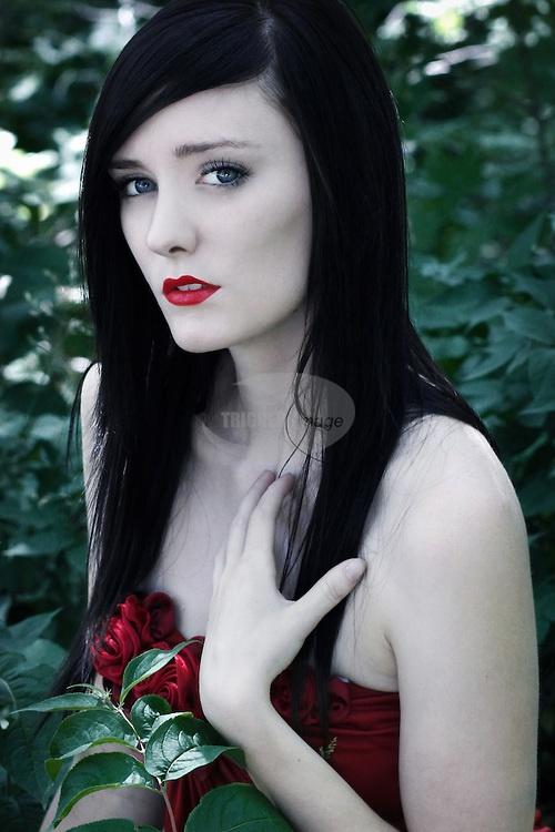 Pale skin, black hair.