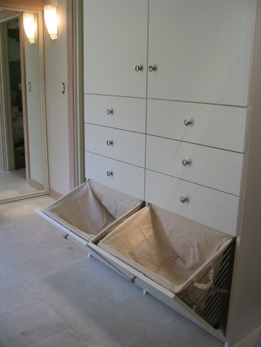Want to do something similar on short walk-in closet wall. Use laundry chute instead of hampers. details contemporary closet