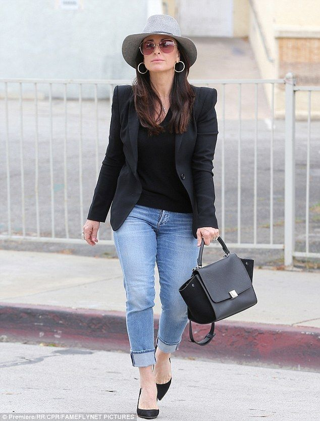 Star style: Kyle, 47, looked stylish in cuffed jeans and a black t-shirt and blazer...