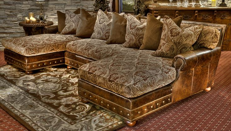 movie room seating or just a cozy place to relax. The light leather and tapestry mix with the nail head trim makes this set appealing in an old world setting as well as the modern living room.