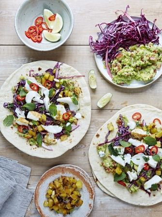 Mexican fish tacos with chunky guacamole, sweet pineapple salsa, garlicky sour cream and a jalapeño-spiked slaw
