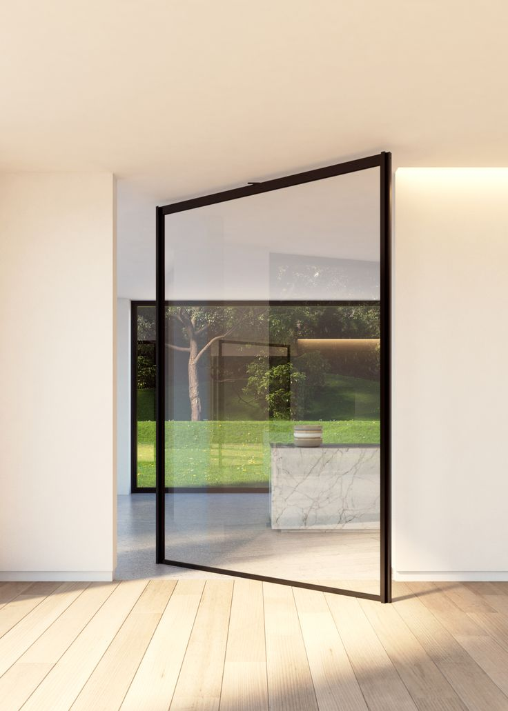 """Glass pivot door """"steel look"""" with central axis pivoting hinge. Custom-made by Portapivot and sold to construction professionals as a DIY kit. #portapivot"""