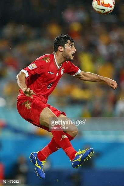 Abdul Aziz AlMaqbali of Oman jumps to control the ball during the 2015 Asian Cup match between Oman and Australia at ANZ Stadium on January 13 2015...