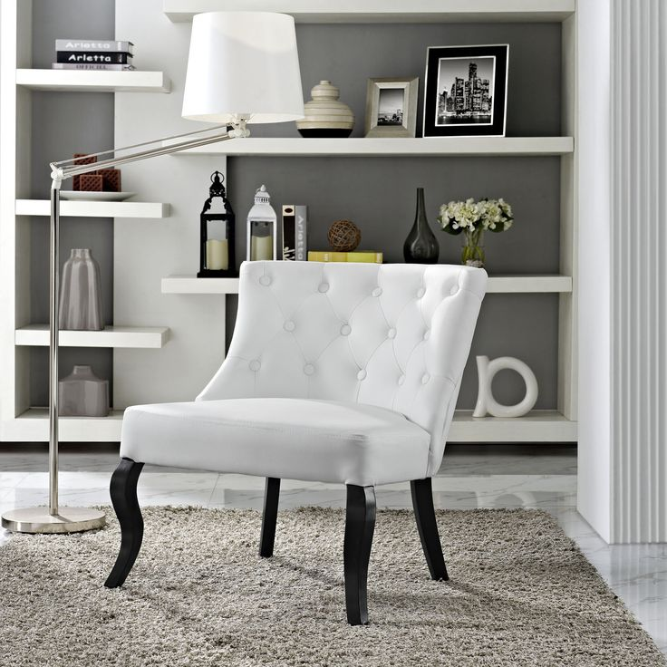 This wide, low profile armchair earns its namesake with luxurious tufting, sculpted legs and subtle curved lines. This classic chair will be the centerpiece of any setting and your favorite place to entertain.
