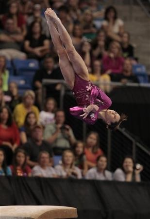 McKayla Maroney vaults during the first night of the 2012 Visa Championships, the qualifying meet for the USA Gymnastics Olympic Trials.  Maroney, the defending world champion on the event, finished atop the event standings during prelims.