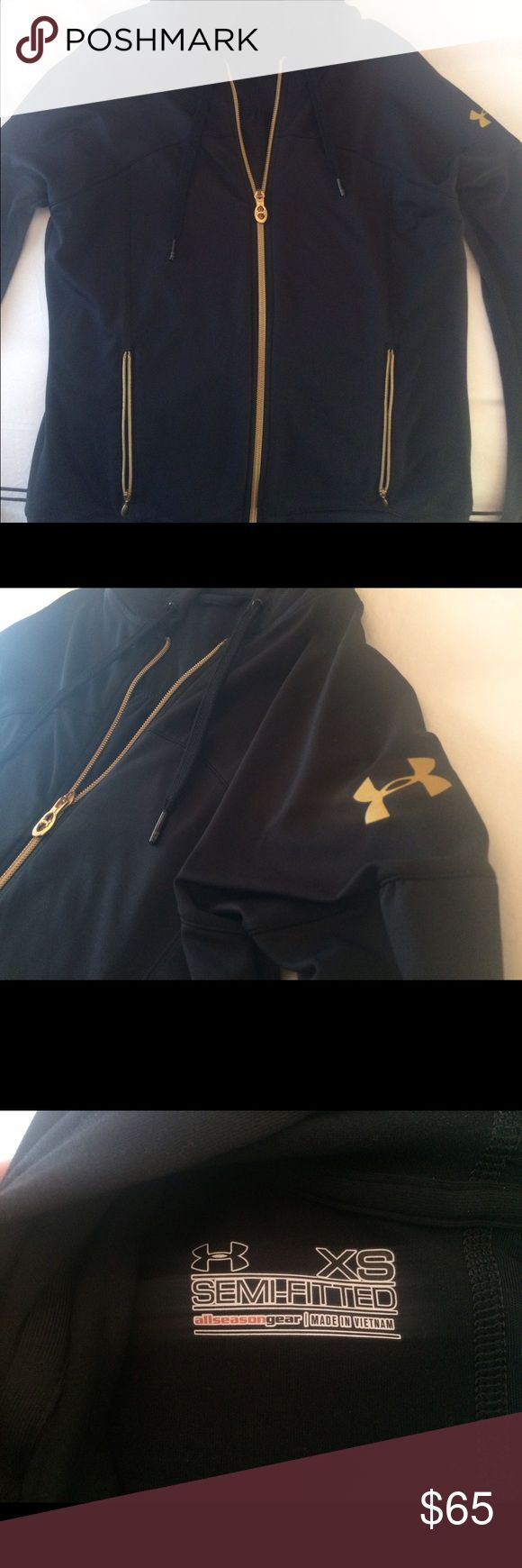 NWOT Under Armour Black and Gold Zip Up Hoodie Excellent condition (worn once!) black zip up Under Armour hoodie with gold hardware. It is semi-fitted for a flattering look! Can fit an XS-M depending on how fitted you like it Under Armour Jackets & Coats