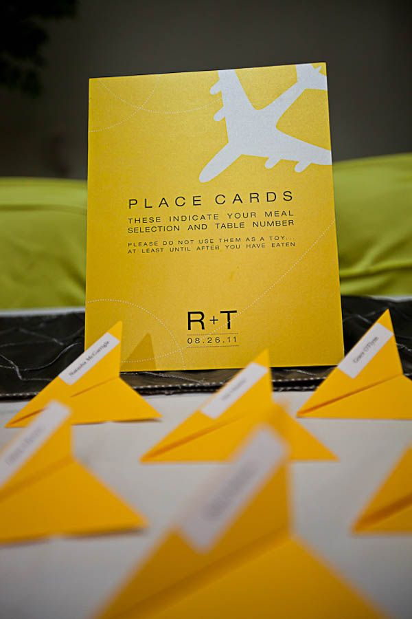 Airplane themed escort cards. Photo by ENV Photography via Rock n Roll Bride.