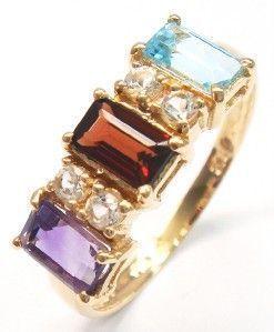 Geelgouden ring ingelegd met natuurlijke amethist  granaat en blauwe topaas. 0.9CT  EUR 0.00  Meer informatie