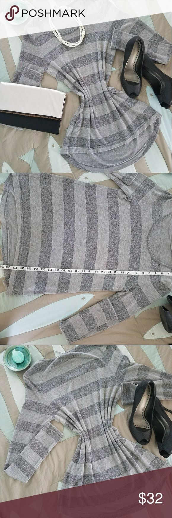 Vince Camuto sexy striped silver & grey sweater This gorgeous Vince Camuto sexy stripe silver and grey sweater is in pre-owned but excellent condition, made of spandex rayon and metallics it's super soft and has the perfect amount of stretch. Sweater is size small, please see photo measurements. Sweater can be dressed up or down, perfect for any occasion!  Sweater is slightly shorter in the front longer in the back, for a bit of high low effect. Vince Camuto Sweaters Crew & Scoop Necks