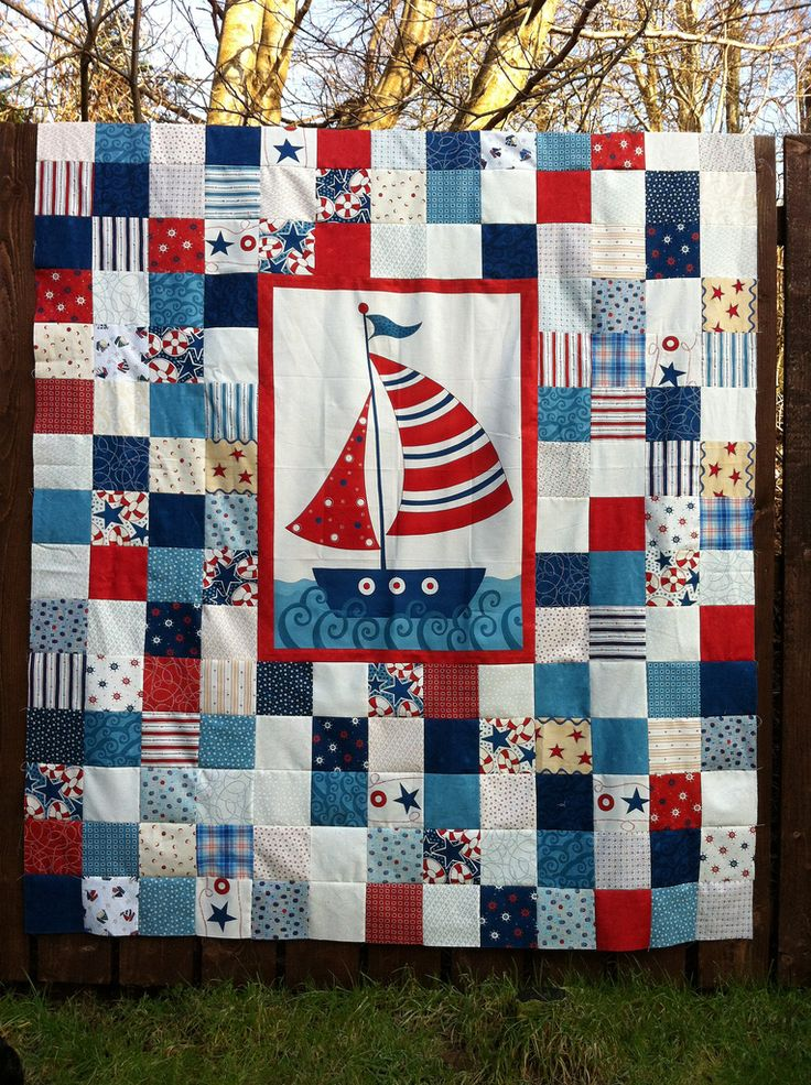 I'm not too fond of the quilt, but the idea of having the panel stick out with the bright border is very wise. Maybe I'll use this idea with Machai's robot quilt.