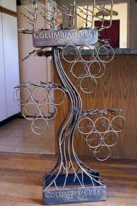 Interesting idea for a DIY wine rack... maybe built-in somewhere but still like a vine or tree...