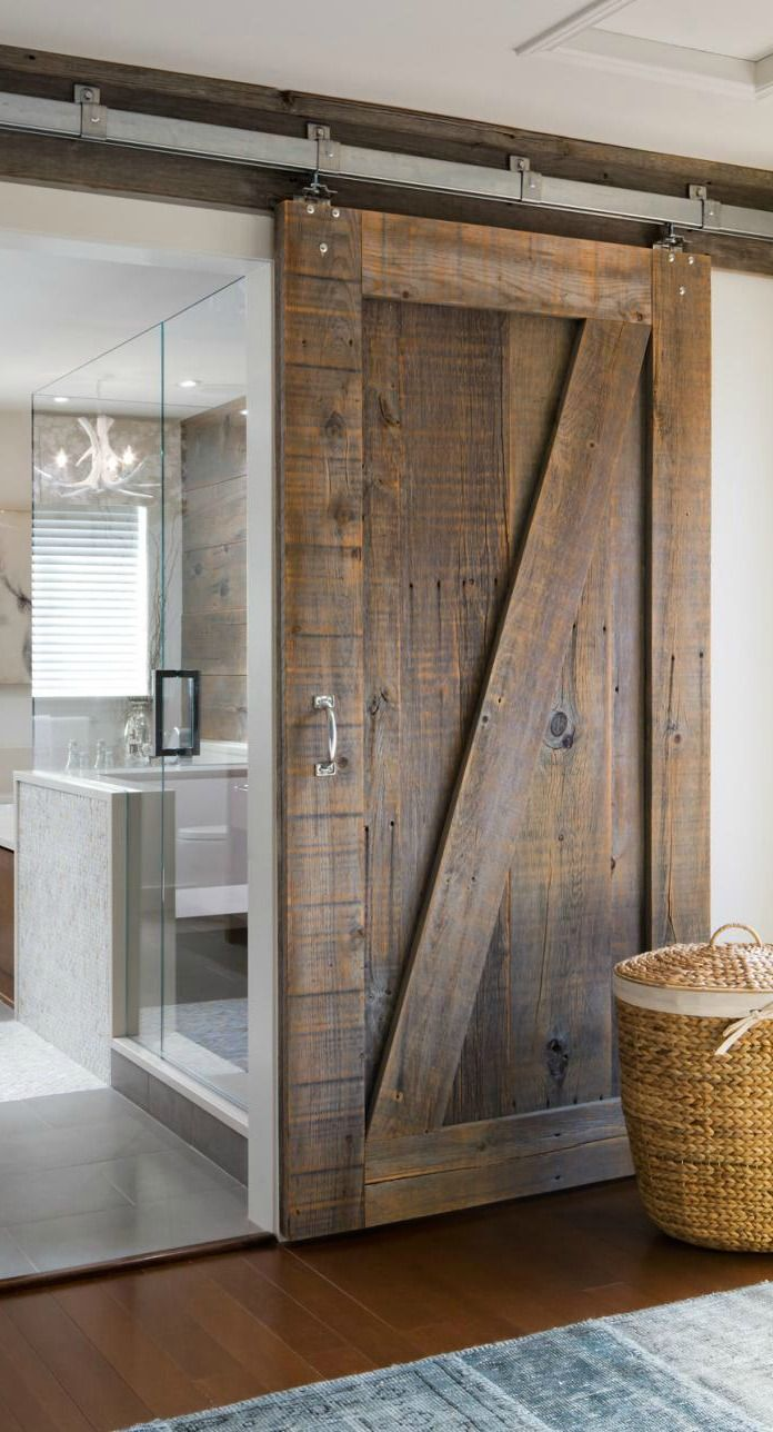 Add character and charm to your master suite by incorporating unique sliding barn doors, sleek tile choices, and a natural color scheme. Relaxation never looked so stylish.