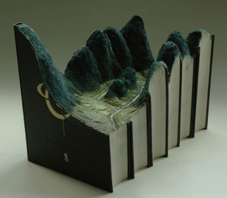 carved book art by Guy Laramee