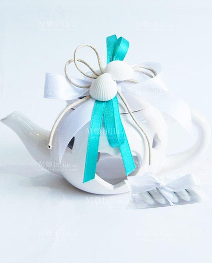 Promozione Lanterna Teiera Bomboniera Conchiglie Innamorate di un meraviglioso color Avorio in ceramica, con dei romantici cuori traforati, ideale per matrimoni e cerimonie.