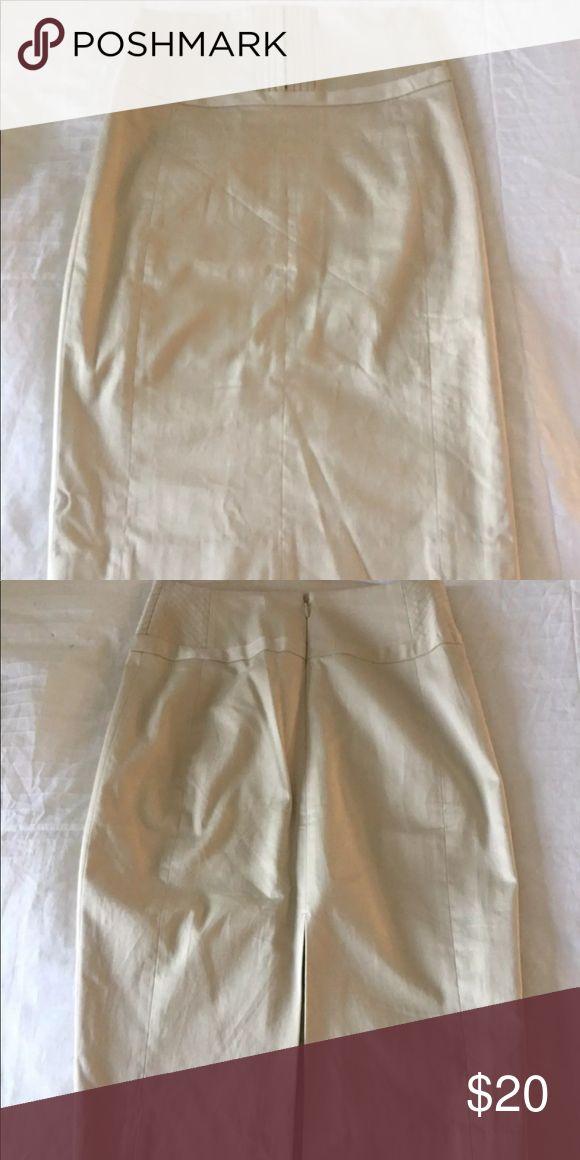 Cute tan pencil skirt. Never been worn. Very cute tan/cream color pencil skirt. Never been worn but no tags. Express Skirts Pencil