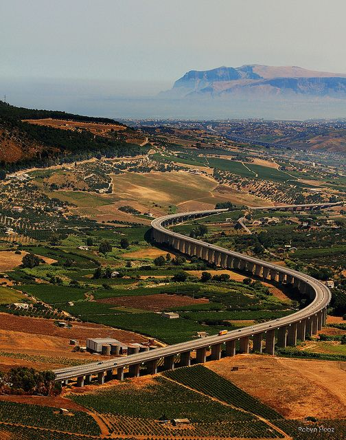 The highway viaduct seen from the temple of Segesta in Sicily, Italy (by Robyn Hooz). -